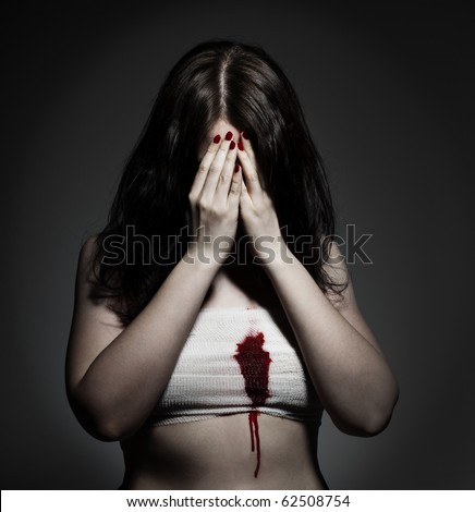 Bleeding heart Sad girl with lover's grief, red fingernails and a bleeding wound at her chest, gauze bandage wrapped around. - stock photo