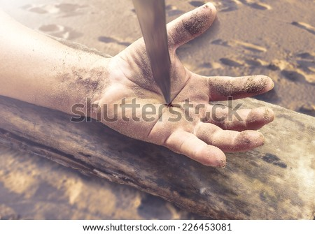 Bleeding leaf Jesus hand with nail in it on wood. Christmas background, Forgiveness, Mercy, Humble, Repentance, Reconcile, Adoration, Glorify, Redeemer, Redemption, Gospel, Love, Faith, Hope concept. - stock photo