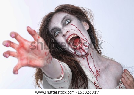 Bleeding Psychotic Woman in a Horror Themed Image - stock photo