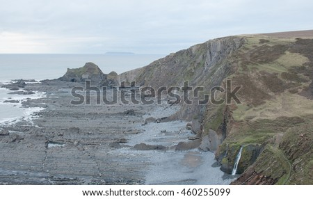 Blegberry Beach With Lundy Island in the Distance on the Atlantic Coast at Low Tide on the South West Coast Path between Clovelly and Hartland Quay, Devon, England, UK. - stock photo