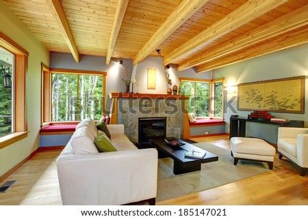 Blend of log cabin interior with elegant black and white furniture. - stock photo