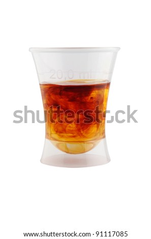 blend of water and iodine in measuring cup - stock photo