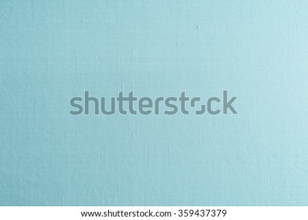 Blended cotton silk fabric wallpaper texture pattern background in light cyan tuquoise blue green color tone: Shiny fine raw natural Thai silk detail textured textile organic fiber burlap backdrop  - stock photo