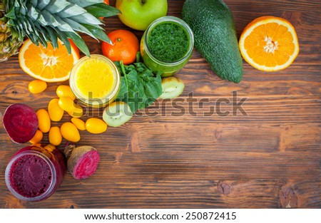 Blended green,yellow and purple smoothie with ingredients selective focus - stock photo