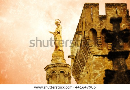 Blessed Virgin Mary. Golden statue of Madonna blessing from the top of Notre Dame Cathedral and the walls of Papal palace in Avignon (France).  Retro aged photo with scratches. - stock photo