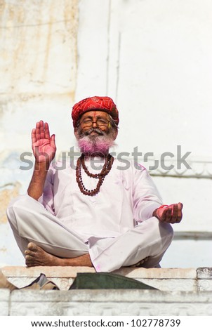blessing of holi man in Pushkar - stock photo