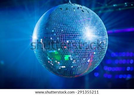 Bleu mirror ball rolling in the night club. - stock photo