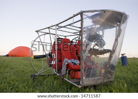 blimp gondola standing on green grass - stock photo