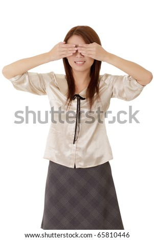Blind business woman put hands on eyes over white.
