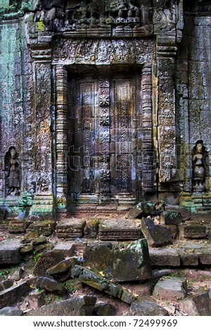 Blind doors to the ancient Buddhist temple in Angkor Wat complex, Cambodia, Siem Reap Province - stock photo