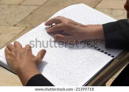 Blind Jew being praying in the wailing wall according to Braille's book. Jerusalem. - stock photo