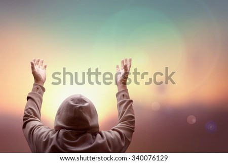 blind man pray over sky with light of hope near the mountain in desert - stock photo
