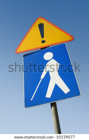 Blind person road traffic sign over clear blue sky - stock photo