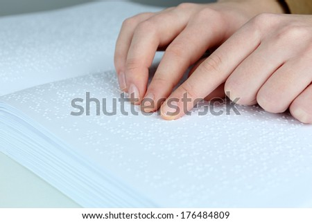 Blind woman read book written in Braille - stock photo