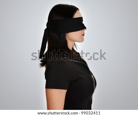 Blindfold business woman, over grey background - stock photo