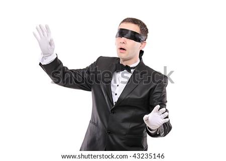 Blindfold elegant man isolated on white background - stock photo