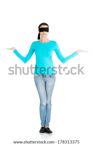 Blindfold woman presenting copy space on her palms, isolated on white - stock photo
