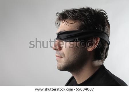 Blindfolded man - stock photo