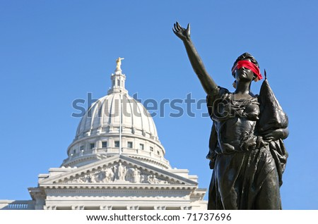 Blindfolded statue outside of Madison, Wisconsin Capitol building, symbolizing oppression. - stock photo