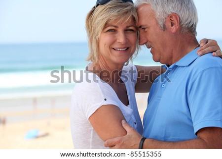 blissful middle-aged couple on holidays - stock photo