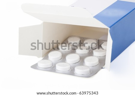 blister pack of pain medication in box, isolated on white background. - stock photo