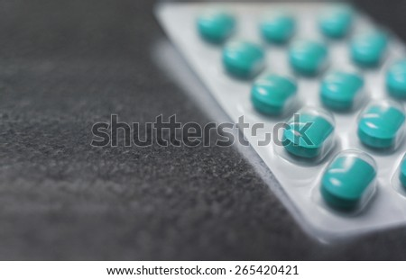Blister pack of Turquoise medicine pills Close up - stock photo