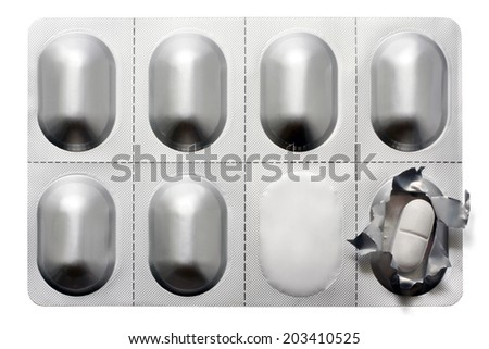 Blister pack with pills isolated on white. Studio shot.  - stock photo