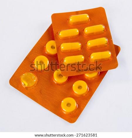 Blister pills on white background. - stock photo