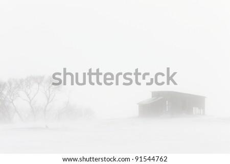 Blizzard and Farm Buildings Saskatchewan - stock photo