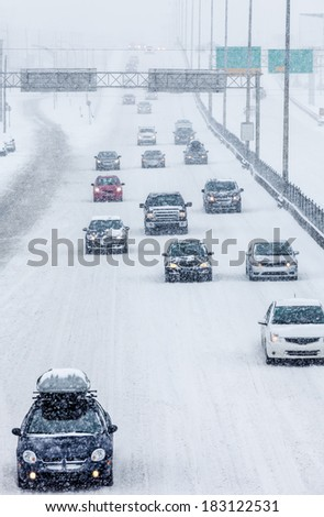 Blizzard on the Road and bad Visibility - all logo, company and car plate removed or modified. - stock photo