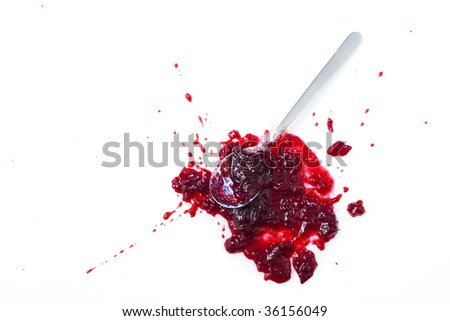 Blob of sour cherry jam with spoon