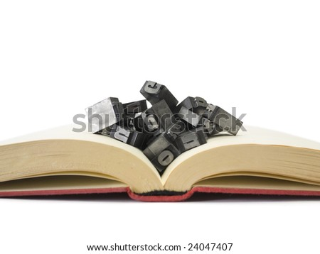 Block letters on open book isolated on white. - stock photo