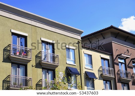 Block of apartments with balconies - stock photo