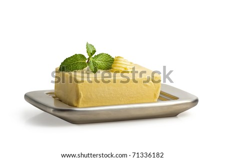 Block of butter on a butter dish. Isolated on white incl. Clipping Path - stock photo