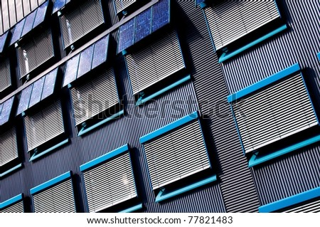 Block of Flats with photovoltaic cells - stock photo
