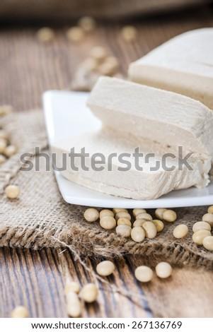 Block of fresh Tofu on wooden background (close-up shot) - stock photo