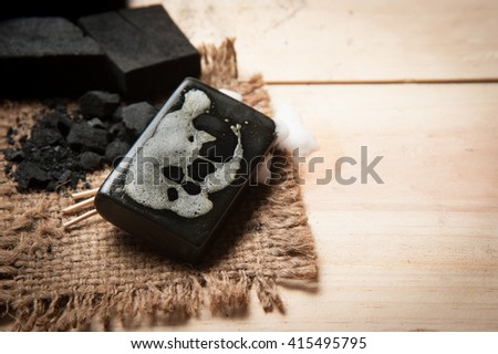 block of natural carbon soap and Black charcoal