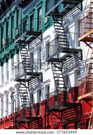 Block of painted apartment buildings in Little Italy in Manhattan, New York City - stock photo