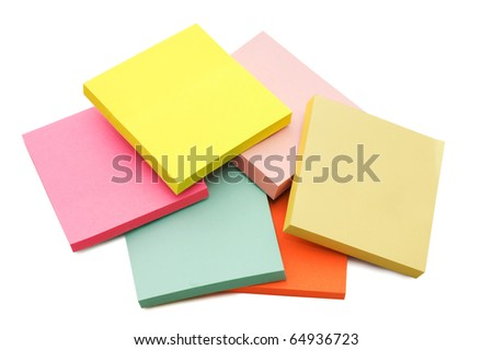 Block of vibrant multicoloured Post it Notes isolated on white - stock photo