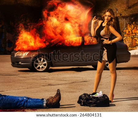 blockbuster. Girl with posh figure stands over a bag full of money EUR amid exploding car. Outdoors - stock photo