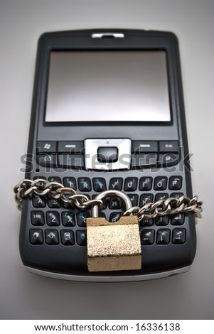 Blocked mobile phone with a chain and lock - stock photo