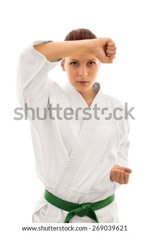 Blocked. Young girl in kimono taking defensive stance isolated on white background - stock photo