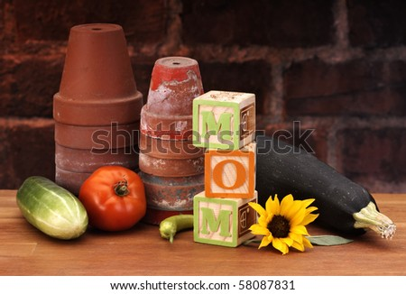 Blocks and posts spelling MOM - stock photo