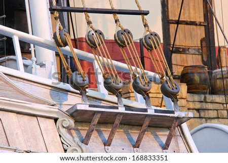 Blocks and ropes on the ancient sailboat - stock photo