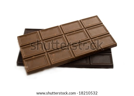 blocks of black and milky chocolate isolated on white