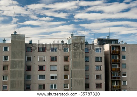 blocks of flat with blue cloudy sky - stock photo