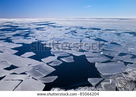 Blocks of ice on the coast of the frozen sea. - stock photo