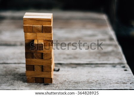 blocks wood game (jenga) on wooden table - stock photo