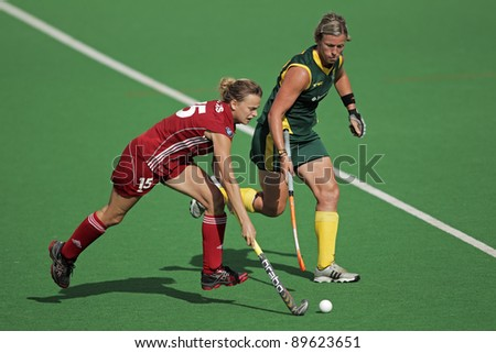 BLOEMFONTEIN, SOUTH AFRICA - FEBRUARY 8: Charlotte de Vos (L) and Tarryn Bright (R) during a womens field hockey match between South Africa and Belgium, Bloemfontein, South Africa, 8 February 2011