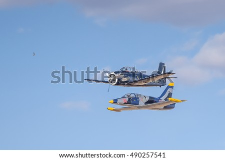 BLOEMFONTEIN, SOUTH AFRICA - JULY 16, 2016: An Aero L-39 Albatros and T 28 Trojan flying in formation in a public display at the Tempe Airport at Bloemfontein